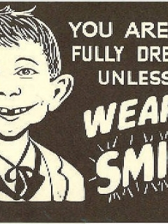 Go to Postcard Pre-MAD Alfred E. Neuman 'Wear a Smile' Placard • USA