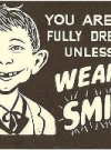 Image of Postcard Pre-MAD Alfred E. Neuman 'Wear a Smile' Placard