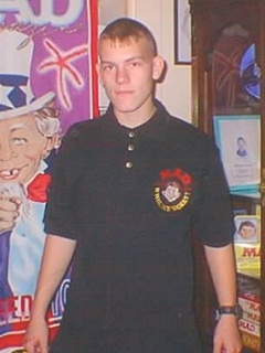 Go to Embroidered Polo Shirt MAD, black