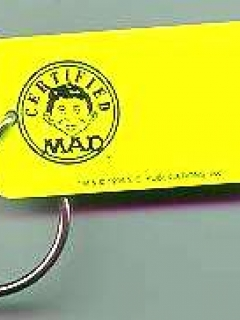 Go to Key Chain 'Certified MAD', yellow • USA