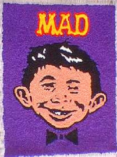 Go to Rug Folk Art with Alfred E. Neuman face • USA
