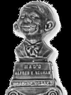Go to Clock with Alfred E. Neuman Bust on top • USA