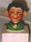 Image of Coin Back Pre-MAD Alfred E. Neuman on Top