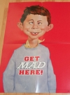 Image of Poster 'Get it here' with Alfred E. Neuman
