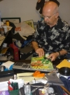 Image of Dick DeBartolo in his MAD office signing Mad magazines