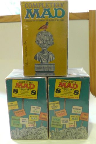Both yellow Completely MAD Gift sets (side view)