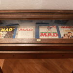 Display with US-MAD #1+24, German MAD #1 and a signed MAD #100.