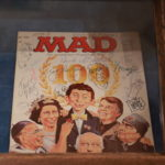 Signed MAD #100, from the MAD Trip to Germany in 1980. Signed by Astalos, Jack Davis, al Jaffee, Paul Peter Porges, Harry North, Paul Coket,Jr., Bob Clarke, Bill Gaines, Jack Rickard, Dick DeBartolo, John Putnam, Angelo Torres, Herbert Feuerstein, Rolf Trautmann, Don Martin and Dave Berg.